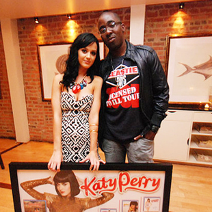 Chris Anokute with Katy Perry, receiving an award for multi-platinum sales.