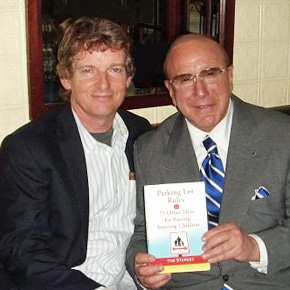 Tom Sturges with music legend Clive Davis (holding Sturges' first book, Parking Lot Rules & 75 Other Ideas for Raising Amazing Children).