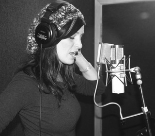 Chantal Kreviazuk recording vocals in the studio.