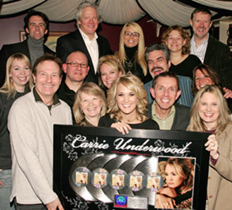Iain Pirie with Carrie Underwood, and execs from her record label and management