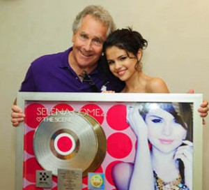 Jon Lind with Selena Gomez, at her gold record award presentation.