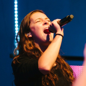 Savannah Stewart performing live.