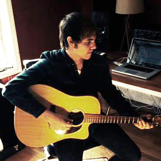Ross Copperman, playing guitar.