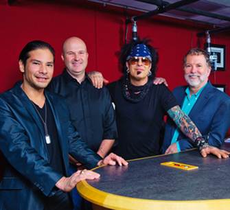 Nikki Sixx of Motley Crue signs with SESAC in 2015. Pictured (l-r): SESAC's Glen Phillips, Sam Kling, Nikki Sixx and SESAC's Dennis Lord