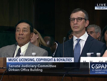 Smokey Robinson and David Israelite at a Senate Judiciary Committee hearing.